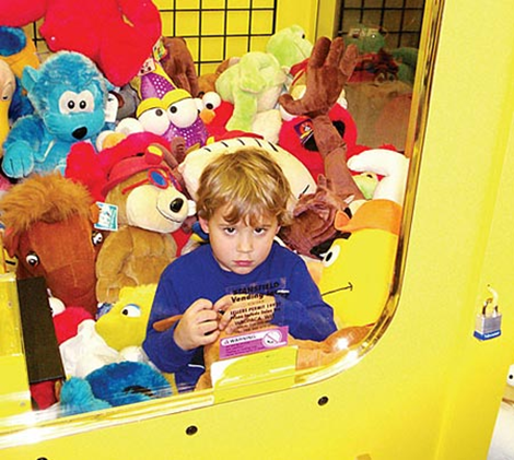 Kid stuck in vending machine crane game