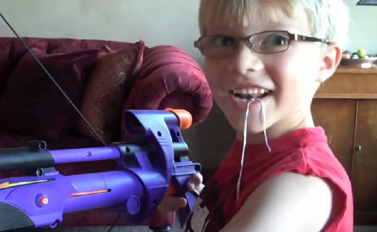 kid pulls tooth with nerf gun